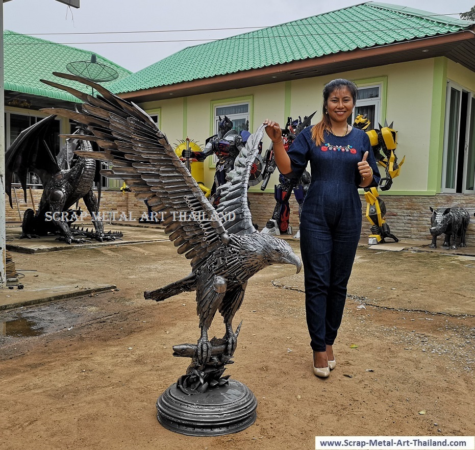 Eagle sculpture statue catching a salmon fish - life size metal animal art from Thailand