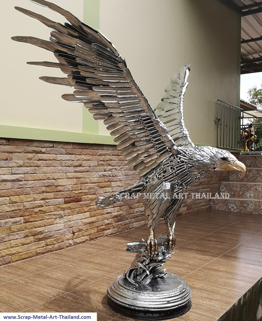 Eagle sculpture statue catching a salmon fish - life size scrap metal animal art from Thailand